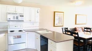 Full-sized fridge, microwave, oven, dishwasher