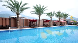 Outdoor pool, open 11 AM to 10 PM, pool umbrellas