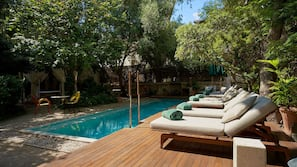 2 outdoor pools, open 8:00 AM to 9:00 PM, pool umbrellas, pool loungers