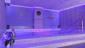 Indoor pool, seasonal outdoor pool, open 8 AM to 8 PM, pool umbrellas