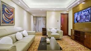 En 32-tommers LED-TV med parabol samt TV