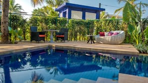 Outdoor pool, open 7 AM to 7 PM, pool loungers