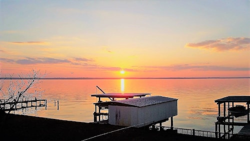 Check Expedia for Availability of Water Front Lake House With Beautiful View of Water and Sunsets!