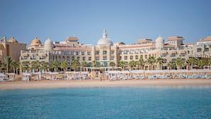 Private beach, beach umbrellas, beach towels, scuba diving