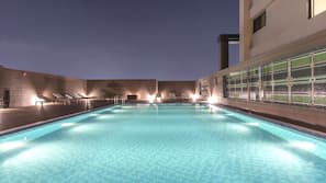 Outdoor pool, open 5:00 PM to 9:00 PM, pool umbrellas, sun loungers