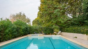 Outdoor pool, open 10:00 AM to 9:00 PM, pool loungers