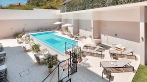 Indoor pool, outdoor pool, open 8:00 AM to 8:00 PM, pool umbrellas