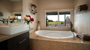 Separate bathtub and shower, jetted bathtub, hair dryer, towels