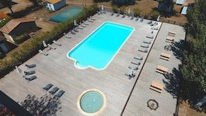 Seasonal outdoor pool, open 10:00 AM to 7:00 PM, pool umbrellas