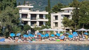 Private beach, sun loungers, beach bar