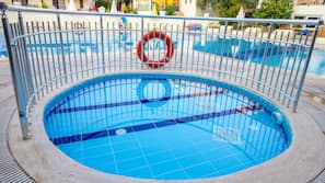 Seasonal outdoor pool, open 9:00 AM to 8 PM, pool loungers