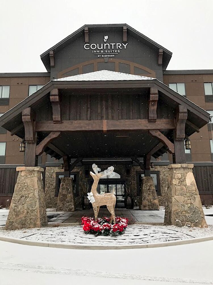 Exterior detail, Country Inn & Suites by Radisson, Kalispell, MT - Glacier Lodge