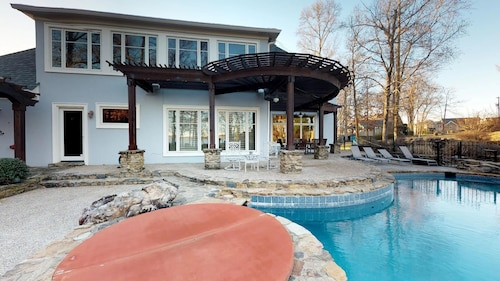 Open Lakefront Floorplan With Infinity Pool, Hot Tub, Sauna, Game Room, and Doc