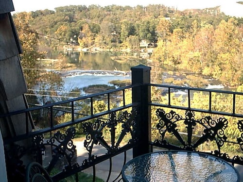 The Charming French Chateau Overlooks the Beautiful Falls of the Spring River