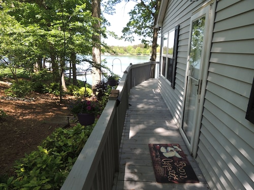 Private Lake Cottage on the Water With Fireplace, With Boat Dock and Huge Deck!