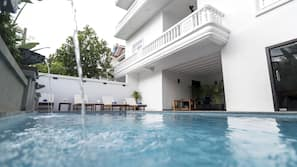Outdoor pool, open 7 AM to 10:30 PM, pool umbrellas, pool loungers