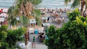 Private beach, black sand, sun-loungers, beach umbrellas