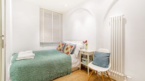 1 bedroom, premium bedding, blackout curtains, iron/ironing board