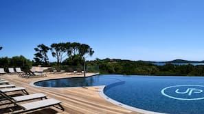 Seasonal outdoor pool, open 8:00 AM to 11:00 PM, pool umbrellas