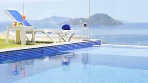 Seasonal outdoor pool, an infinity pool, sun loungers