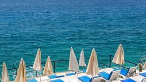 Sun-loungers, beach umbrellas, beach bar