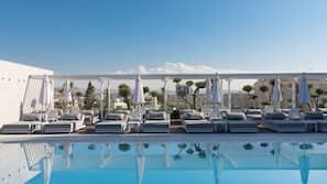 Seasonal outdoor pool, open 9 AM to 7:00 PM, free cabanas