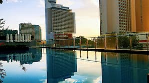 Outdoor pool, open 6:00 AM to 7:00 PM, pool umbrellas
