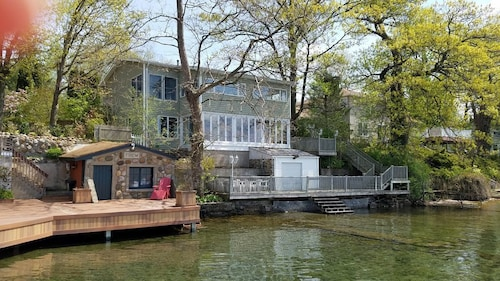 Great Place to stay Beautiful Canandaigua Lake Sunsets Await you in This Lakefront Property. Cheers! near Rushville