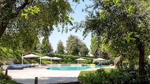 Seasonal outdoor pool, open 10:00 AM to 6:30 PM, pool umbrellas