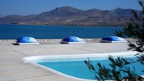 Seasonal outdoor pool, open 10:30 AM to 9:30 PM, sun loungers