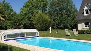 Seasonal outdoor pool, open 10 AM to 9 PM, sun loungers