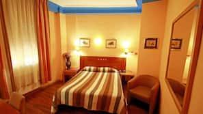 Coffre-forts dans les chambres, fer et planche à repasser