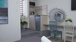 Fridge, microwave, electric kettle, cookware/dishes/utensils