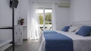 Blackout drapes, iron/ironing board, bed sheets