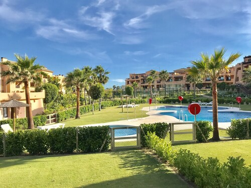 Casares Beach Golf Apartment With Private Garden and Pool Access