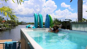Outdoor pool, open 8:00 AM to 9 PM, pool loungers