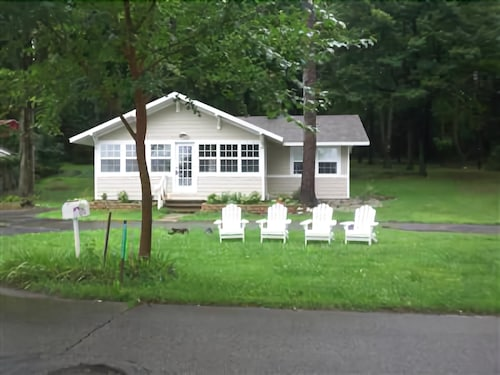 Great Place to stay Dewey Lakefront Home on Wooded Lot and 225 Acre All Sport Lake near Dowagiac