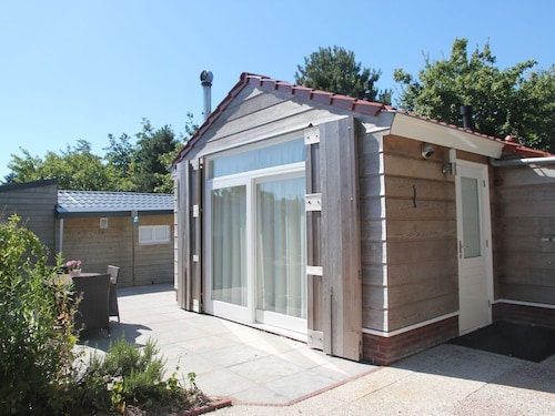 Comfortable Chalet With Spacious Terrace in a Small Park Close to the Beach