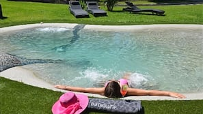 Seasonal outdoor pool, open 9:00 AM to 6:30 PM, pool loungers