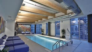 Indoor pool, open 7:00 AM to 10 PM, pool loungers