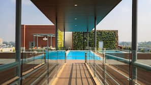 Outdoor pool, open 6 AM to 10 AM, free pool cabanas