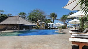 Outdoor pool, open 7 AM to 6 PM, pool umbrellas, sun loungers