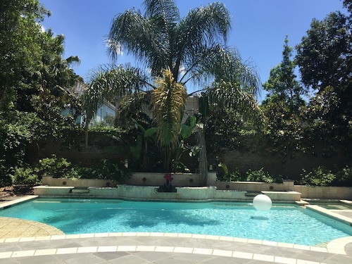 Great Place to stay Luxe 4bdrm Private Uptown Mansion Pool, Gardens, Streetcar <8min French Qtr near New Orleans