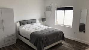 Ferros/tábuas de passar roupa, acesso à internet, roupa de cama