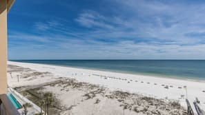 On the beach, white sand, sun loungers