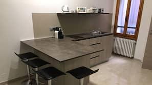Full-size fridge, stovetop, coffee/tea maker, electric kettle