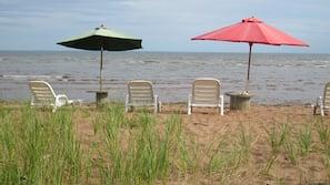 On the beach, sun-loungers