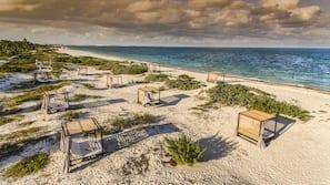 Private beach, beach umbrellas, beach volleyball, beach bar