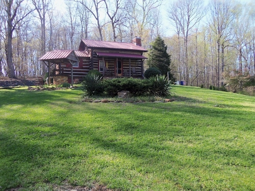 A Authenic Early American Cabin Located on a Eighty Acre Farm in NC Foothills