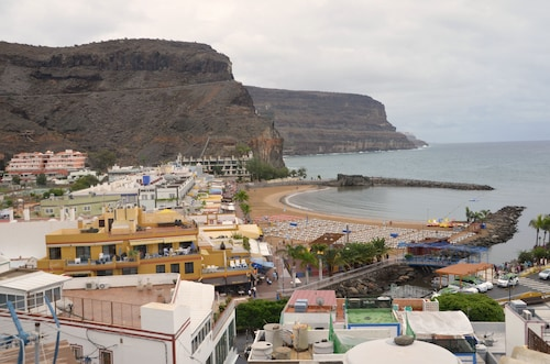 Playa de mogan holidays 2019 playa de mogan short breaks expedia - Pension eva puerto de mogan ...